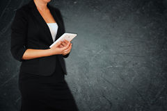 Woman in business suit on gray abstract elegant textured background. filtered image Stock Photos