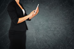 Woman in business suit on gray abstract elegant textured background. filtered image. Royalty Free Stock Image