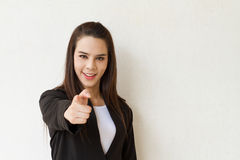 Woman in business suit hand pointing forward with text space Stock Images