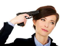 Woman in business suit holding a gun. Stock Images
