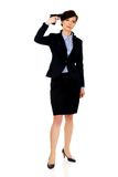 Woman in business suit holding a gun. Royalty Free Stock Image