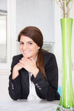 Woman in business suit at home royalty free stock photo