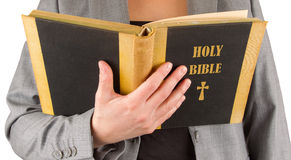 Woman in business suit is reading a holy bible Stock Photo