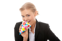 Woman in business suit wearing party favors Royalty Free Stock Photography