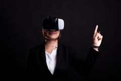 Woman in business suit wearing a VR headset Royalty Free Stock Image