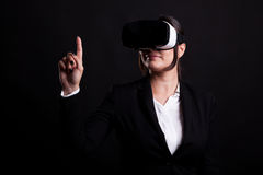 Woman in business suit wearing a VR headset Royalty Free Stock Images
