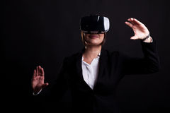 Woman in business suit wearing a VR headset Royalty Free Stock Photos