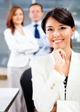 Woman with a business team Stock Photography