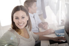Woman in business training working on computer. Woman in business training sitting in front of desktop royalty free stock images
