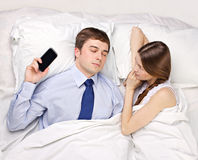 Woman and businessman in bed Royalty Free Stock Image