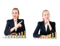 The woman businessman with coins on white Stock Image