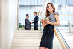Woman businessman stands on the stairs looking at the camera. Be stock image