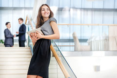 Woman businessman stands on the stairs stock photography