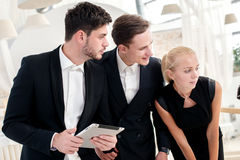 Woman Businessman talking on a mobile phone. Young businessman s. Tanding on the steps and keeps his hands in his pockets while her parnery talk to each other Stock Photo