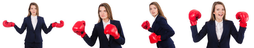 The woman businesswoman with boxing gloves on white Stock Photos