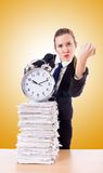 Woman businesswoman with the clock and papers Stock Image
