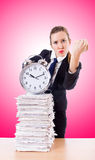 Woman businesswoman with the clock and papers Royalty Free Stock Photo