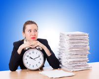 Woman businesswoman with the clock and papers Royalty Free Stock Photos