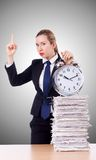 Woman businesswoman with the clock and papers Royalty Free Stock Images