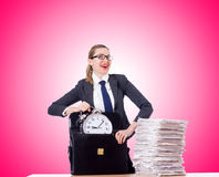 Woman businesswoman with the clock and papers Stock Photography