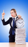 Woman businesswoman with clock and papers Stock Photography