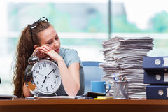 The woman businesswoman failing to meet her deadlines Stock Photo