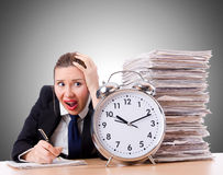 Woman businesswoman with giant alarm clock Stock Photography