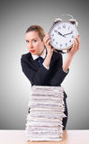 Woman businesswoman with giant alarm clock Royalty Free Stock Photography