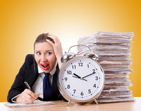 Woman businesswoman with giant alarm clock Royalty Free Stock Image