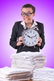 Woman businesswoman with giant alarm clock Royalty Free Stock Images