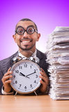 The woman businesswoman with giant alarm clock Royalty Free Stock Photos