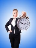 Woman businesswoman with the giant clock Royalty Free Stock Photo