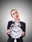 Woman businesswoman with the giant clock Royalty Free Stock Image