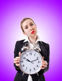 Woman businesswoman with giant clock Stock Image