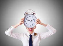 Woman businesswoman with giant clock Stock Images