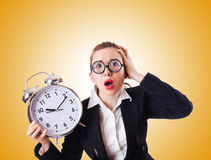 Woman businesswoman with giant clock Stock Photo