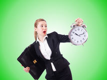 Woman businesswoman with giant clock Royalty Free Stock Photography