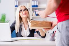 The woman businesswoman receiving mail parcel from courier. Woman businesswoman receiving mail parcel from courier Stock Image