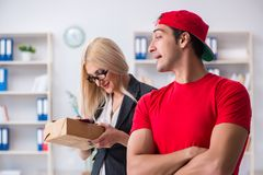 The woman businesswoman receiving mail parcel from courier. Woman businesswoman receiving mail parcel from courier Royalty Free Stock Photography
