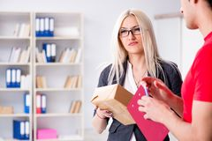 The woman businesswoman receiving mail parcel from courier. Woman businesswoman receiving mail parcel from courier Stock Images