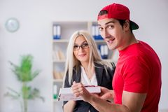 The woman businesswoman receiving mail parcel from courier. Woman businesswoman receiving mail parcel from courier stock photos