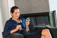 Woman businesswoman texting mobile phone living room Royalty Free Stock Photography