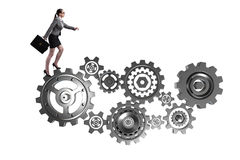 The woman businesswoman walking in cogwheels isolated on white Royalty Free Stock Photography