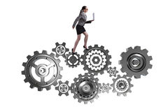 The woman businesswoman walking in cogwheels isolated on white Royalty Free Stock Images