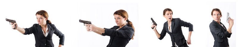 The woman businewoman with hand gun Royalty Free Stock Images