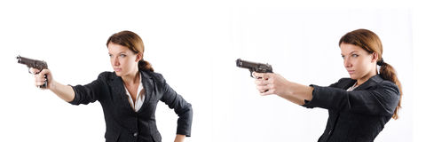 The woman businewoman with hand gun Stock Images