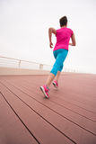 Woman busy running on the promenade Royalty Free Stock Photography