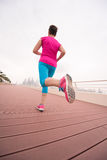 Woman busy running on the promenade Stock Photo