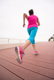 Woman busy running on the promenade Stock Images
