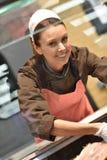 Woman butcher at work Stock Photos